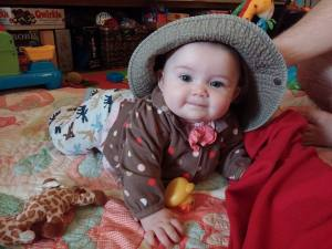 Baby Girl in daddy's hat
